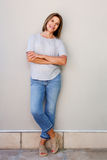 Attractive senior woman smiling with arms crossed stock image