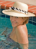 Attractive Senior Woman in Spa. This shot of a senior woman in a whirlpool was taken using natural sunlight Stock Photo