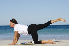Attractive senior woman stretching at beach Stock Photo