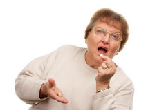 Attractive Senior Woman Taking Pills Stock Photo