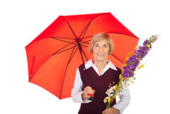 Attractive senior woman with umbrella Royalty Free Stock Photography