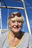 Attractive senior women with blonde hair on a boat Stock Photo