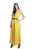 Attractive sensual beauty in ocher jumpsuit looking at camera Stock Photos