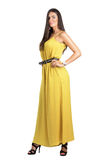 Attractive sensual fashion woman in yellow jumpsuit posing with hand on hip. Full body length portrait isolated over white studio background Stock Photos