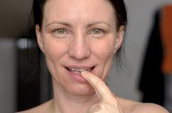 Attractive sensual woman with finger to her lips royalty free stock image