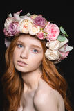 Attractive sensual woman with long wavy hair in rose wreath Royalty Free Stock Image
