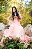Attractive sensual woman in pink dress. Autumn, fall Stock Photo