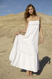 Attractive and sensuality woman dancing in the desert. Fashionable young attractive and sensuality brunette woman in white dress dancing on the desert Royalty Free Stock Images