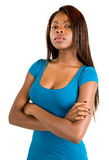 Attractive and Serious African American Lady. An attractive and serious African American lady has her arms crossed while standing with a serious look royalty free stock photography