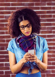 Attractive serious hipster texting Stock Images