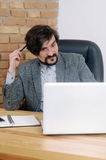 An attractive serious thinking businessman having a lot of work Royalty Free Stock Images