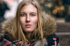 Attractive serious young blond woman Stock Photography