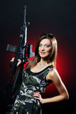 Attractive and sexy army girl with assault rifle Stock Photos