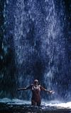 Attractive and Asian woman feeling happy and free wet under beautiful waterfall nature landscape in tourism Summer holidays t stock image
