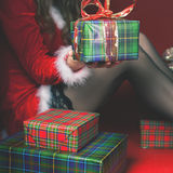 Attractive sexy babe holding gift box, Christmas present Stock Photos