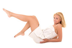 Attractive sexy blond in towel lying over white Stock Images