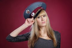 Attractive sexy blond woman in service cap Stock Photos