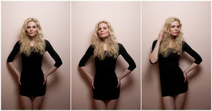 Attractive sexy blonde in black short tight fit dress posing provocatively indoor. Portrait of sensual woman. In classic boudoir scene against a wall. Beautiful Royalty Free Stock Photos