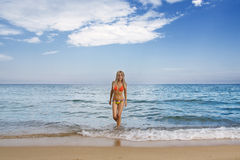 Attractive and sexy blonde girl on the beach Royalty Free Stock Photos