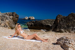 Attractive and blonde girl on the beach Royalty Free Stock Images
