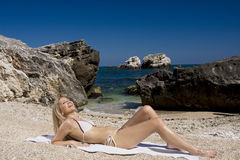 Attractive and blonde girl on the beach Royalty Free Stock Photos