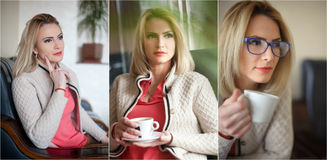 Attractive sexy blonde in white sweater over pink blouse holding a cup of coffee. Portrait of sensual woman sitting Royalty Free Stock Photography