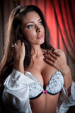 Attractive and sexy brunette with white lace bra Royalty Free Stock Photography