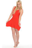 Attractive Sexy Cute Young Blonde Woman Wearing a Short Red Mini Dress. Attractive cute Sexy Young Blonde Haired Woman in Her Twenties Wearing a Short Red Mini Stock Photography