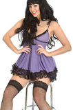 Attractive Sexy Desirable Seductive Young Model Posing In Purple Babydoll Lingerie and Fishnet Stockings Royalty Free Stock Images