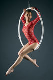 Attractive girl posing on aerial hoop Royalty Free Stock Images