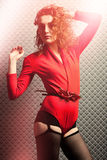 Attractive sexy girl in red with curly hair Royalty Free Stock Photo