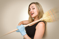 Attractive and sexy housewife. Holding a Broom Stock Image