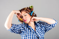 Attractive housewife with curlers. Portrait of attractive housewife with curlers stock images