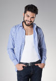 Attractive sexy man with beard dressed casual Stock Images