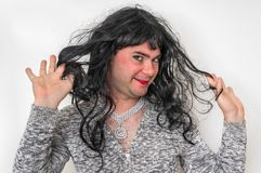 Attractive man wearing makeup looks like as a woman stock images