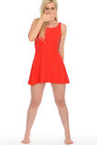 Attractive Sexy Shocked Young Blonde Woman Wearing a Short Red Mini Dress Royalty Free Stock Images