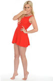 Attractive Sexy Shocked Young Blonde Woman Wearing a Short Red Mini Dress Royalty Free Stock Image