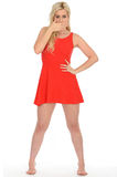 Attractive Sexy Shocked Young Blonde Woman Wearing a Short Red Mini Dress Royalty Free Stock Photos