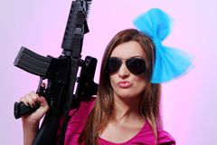 Attractive and sexy spy woman with assault rifle Royalty Free Stock Photo
