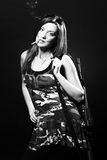 Attractive and sexy spy woman with assault rifle Royalty Free Stock Image