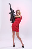 Attractive and spy woman with assault rifle stock photo