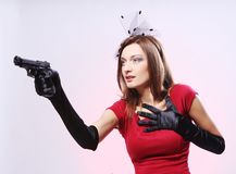 Attractive and sexy spy woman with pistol Stock Images