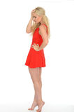 Attractive Sexy Thoughtful Young Blonde Woman Wearing a Short Red Mini Dress. Attractive Sexy thoughtful Young Blonde Haired Woman in Her Twenties Wearing a Stock Images