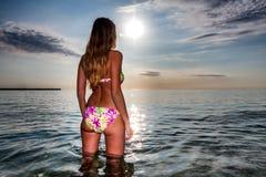 Attractive sexy woman in bikini stand in calm sea water Royalty Free Stock Photo