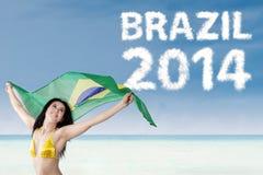 Attractive sexy woman holding brazilian flag Stock Photos
