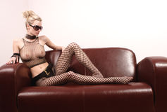 Attractive sexy woman on leather sofa Stock Images