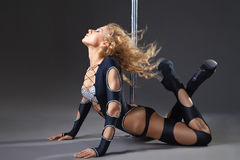 Attractive sexy woman pole dancer performing Stock Photo