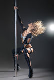 Attractive sexy woman pole dancer performing Stock Image