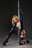 Attractive sexy woman pole dancer performing Royalty Free Stock Photo