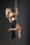 Attractive sexy woman pole dancer performing Royalty Free Stock Images